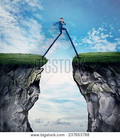 Fantasy Business Concept As A Businessman With Long Legs Run And Leap Over A Chasm Obstacle. Symbol