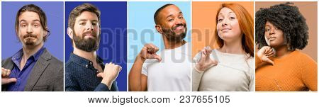 Group of cool people, woman and man proud, excited and arrogant, pointing with victory face