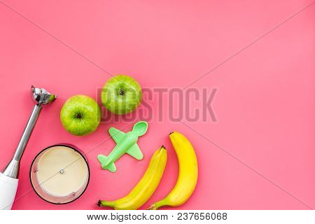 Homemade Baby Food. Cook Puree With Apple And Banana With Immersion Blender. Pink Background With To