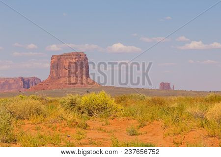 View On Merrick Butte, East And West Mitten Butte From Road. Navajo Park Of Monument Valley. Arizona