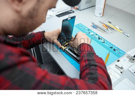 Skilled Professional Male Technician From Electronics Repair Service Removing Screen Glass From Mobi