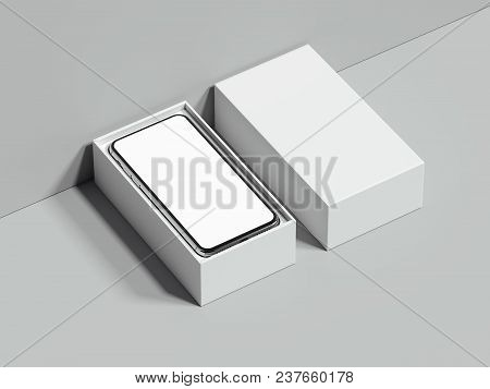 White Opened Rectangular Box With Mobile Phone Inside Stands Next To The Grey Wall And On Grey Floor