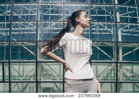 Beautiful Athletic Girl Is Gaining Strength And Energy Before Training Outdoors In The Sun