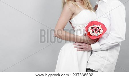 Closeup Of Couple With Candy Bunch Flowers. Love.