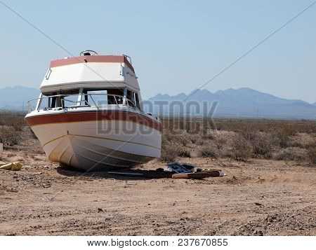 An Abandoned Boat Marooned In The Vast Arizona Desert.
