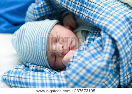 Cute Eurasian newborn baby sleeping