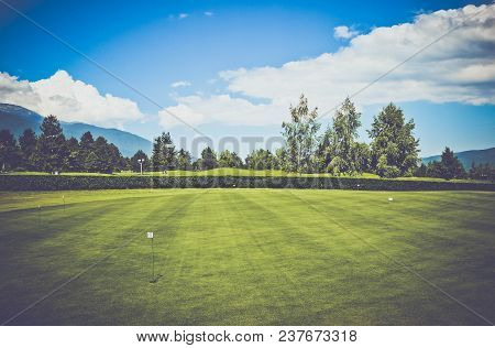 Photo Depicts A Beautiful Colorful Mountain Meadow Landscape, Clipped Lawn, Spruce Fir Trees, Summer