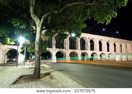 Famous Lapa Arches, Also Known As Carioca Aqueduct, At Night In Rio De Janeiro, Brazil