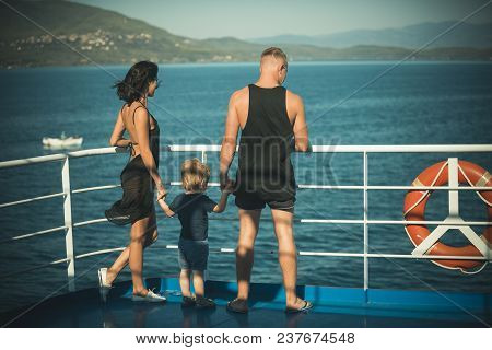 Family Travelling On Cruise Ship On Sunny Day. Family With Cute Son On Summer Vacation. Father, Moth