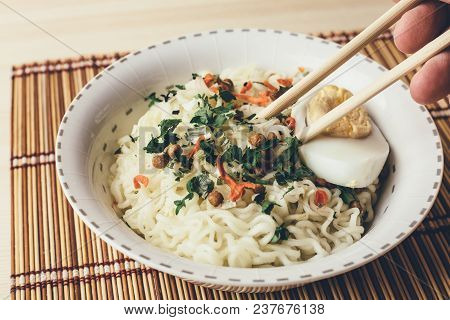 Instant Noodles In Bowl, Asian Cheap Fast Food On Wooden Table