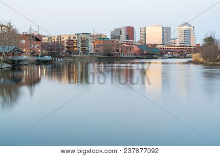 Wilmington, De - April 5, 2018: Wilmington, Delaware Skyline And Riverwalk  Along The Christiana Riv