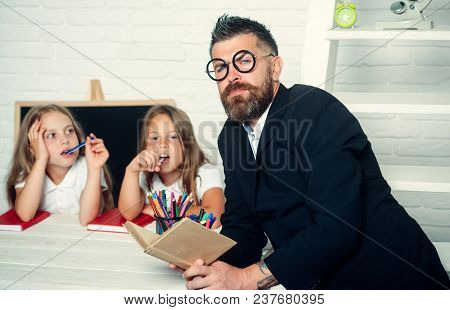 Education In Knowledge Day. Literature Lesson And Reading Grammar Book. Teacher Man Read Story To Gi