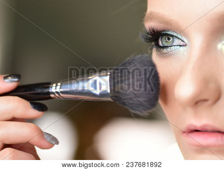 Beautiful Young Girl With Blue Eyes Posing With Tassel For Applying Makeup. Closeup Portrait Of Mode