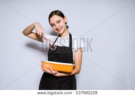 Happy Young Girl Cook In Black Apron Preparing A Delicious Meal For Dinner, Smiling