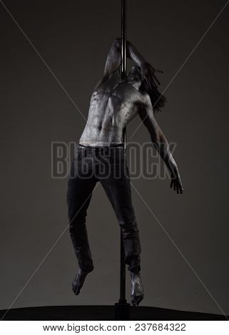 Man With Nude Torso Covered With Shimmering Silver Paint, Dark Background. Athlete, Sportsman Perfor