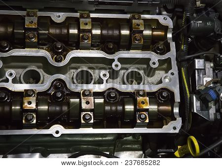 cover of block of petrol engine with cam-shafts poster