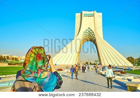Tehran, Iran - October 24, 2017: The Young Tourist Makes A Picture Of Azadi Tower With Tehran City O