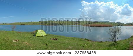 green tent on a idyllic meadow by the Biviere Lake in Nebrodi Park, Sicily