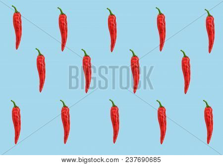 Flat Lay Red Chili Peppers Pattern On Ligh Blue T Background. Top View. Abstract