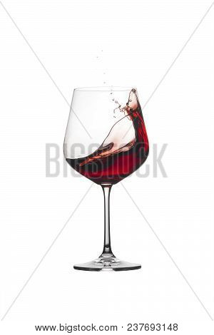 Red Wine Splashing Out Of A Glass, Isolated On White Background. Wine With Splash.