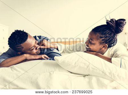 A couple lying in bed together