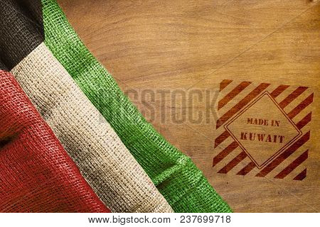 Flag Of Kuwait Made From Rough Fabric And Stamp Made In Kuwait