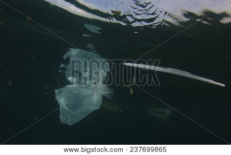 Plastic ocean pollution. Plastic bags, bottles, straws and cups pollute the sea. Underwater reef environmental problem