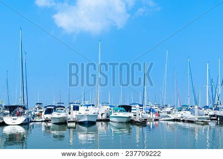 Yacht Harbor On Blue Sky Sunset Light Background, Vacation Holidays Concept Yachts In The Sea Port,