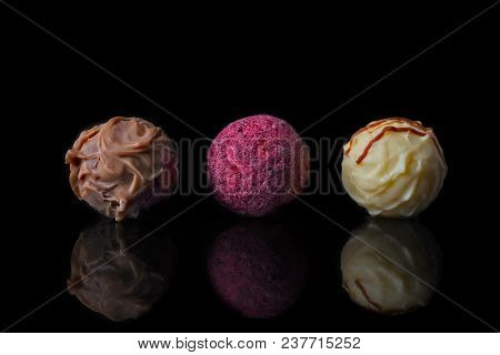 Finest Chocolate Pralines Isolated On Black Backgound