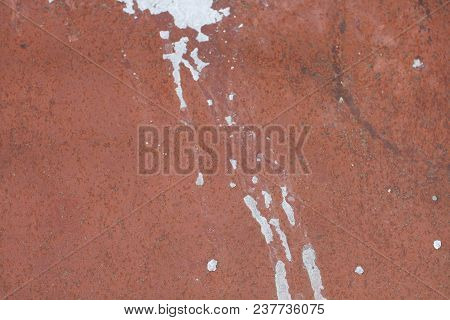 Texture Of Wall Stains After White Rain. Background Of Wall Stains. Stains On Red Wall.