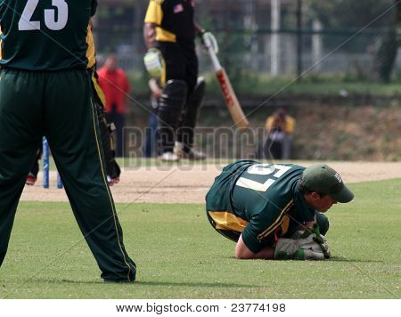 PUCHONG, MALAYSIA - SEPT 24: Tom Kimber (57), Guernsey catches the ball in this Pepsi ICC World Cricket League Div 6 finals vs Malaysia at the Kinrara Oval on September 24, 2011 in Puchong, Malaysia.