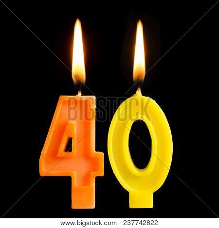 Burning Birthday Candles In The Form Of 40 Forty Figures For Cake Isolated On Black Background. The