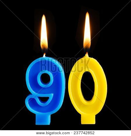 Burning Birthday Candles In The Form Of 90 Ninety Figures For Cake Isolated On Black Background. The