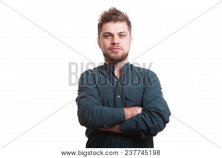Cool Looking Guy Posing In Studio Over White Background