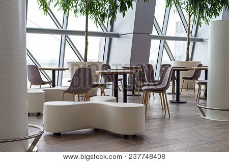 Empty Cafe In The Airport Chairs And Tables, Modern Building.