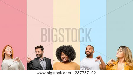 Cool group of people, woman and man proud, excited and arrogant, pointing with victory face