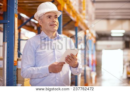 Delivery Service. Joyful Nice Man Working As A Logistic Manager In The Warehouse