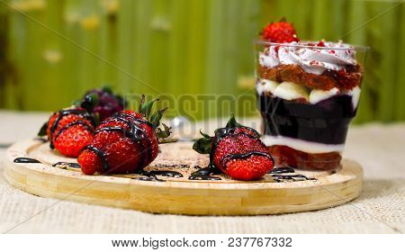 Sweet English Trifle Dessert With Blueberry Cream And Strawberries On A Green Wooden Background.love