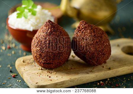 kibbeh, a levantine dish, on a rustic wooden table