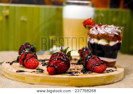 Sweet English Trifle Dessert With Blueberry Cream , Strawberries And Gkass Of Coffee Latte Back On A