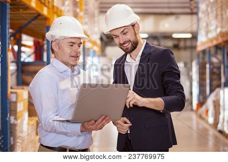 My Ideas. Delighted Nice Man Pointing At The Laptop Screen While Describing The Idea To His Manager