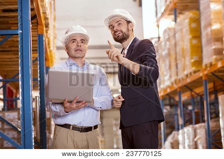 Business Innovation. Positive Delighted Businessman Talking To His Manager While Suggesting Some Ide