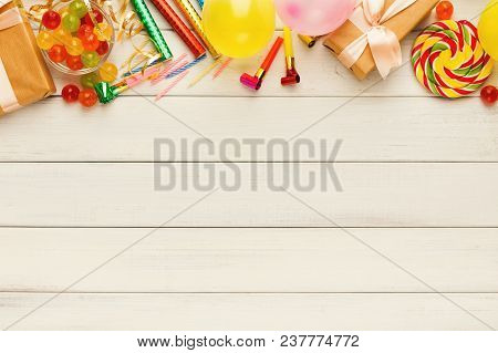 Carnival Or Party Border Of Colorful Balloons, Top View. Holiday Decorations, Lollipops And Confetti