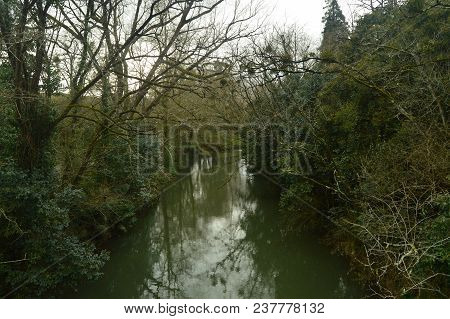 River Very Close To Butron Castle, Castle Built In The Middle Ages. River Nature Travel. March 24, 2