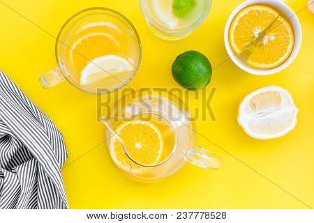 Brew Fruit Tea. Teacup And Teapot Near Orange, Lime, Lemon, Grapefruit On Yellow Background Top View