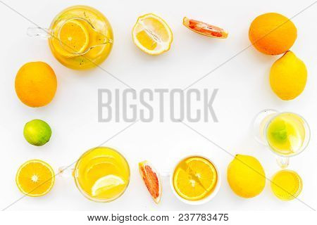 Fruit Tea. Teacup And Teapot Among Citrus On White Background Top View.