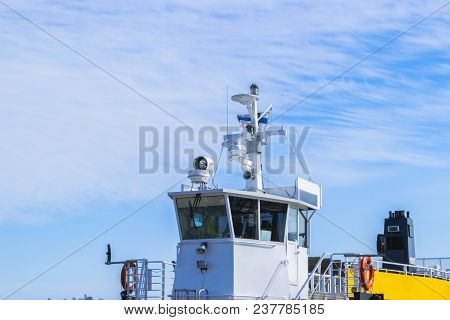 Ferry Boat White Cabin With Big Windows. Wing Of Running Bridge Of Cruise Liner. White Cruise Ship O