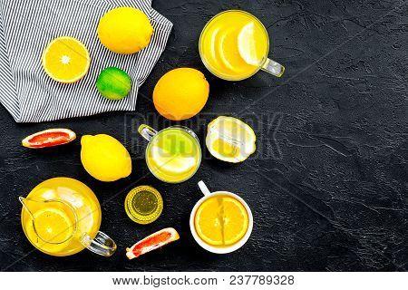 Refreshing Summer Tea With Fruits. Teacup And Teapot Near Orange, Lime, Lemon, Grapefruit On Black B