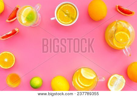 Refreshing Summer Tea With Fruits. Teacup And Teapot Near Orange, Lime, Lemon, Grapefruit On Pink Ba