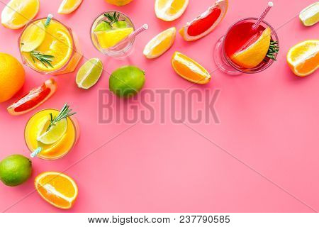 Tropical Fruit Cocktail With Alcohol. Glass With Beverage Near Oranges, Grapefruit, Lime And Rosemar